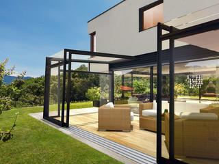 Opened retractable patio enclosure CORSO Ultima