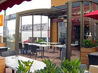 Outside patio enclosure for cafe - it enlarged their place nearly two times