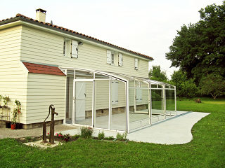 Patio enclosure CORSO with white aluminium frames