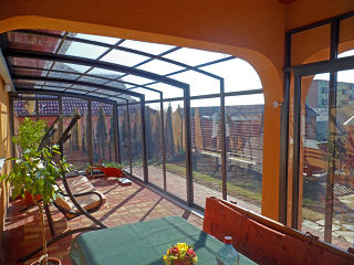 Patio enclosure CORSO Premium fits great to your house with dark color of aluminum frames