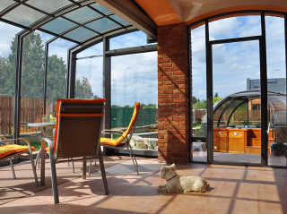 Retractable patio cover CORSO Premium by Pool and Spa Enclosures LLC - A look from the inside