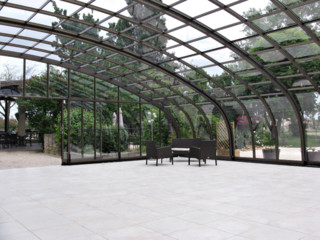 Retractable patio enclosure CORSO for large outdoor public seating area