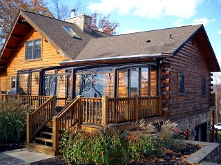 Patio enclosure Corso Premium fits great even on the wooden cabin