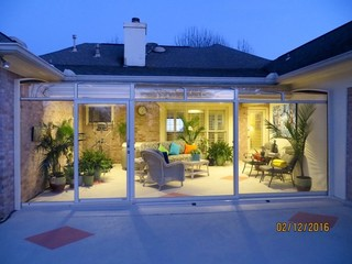 Patio enclosure  sunroom CORSO Premium in the evening - premium patio deserves a Premium