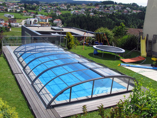 Regular inground pool covered by ELEGANT enclosure