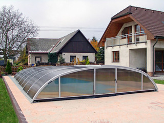 Retractable swimming pool enclosure ELEGANT with white profiles
