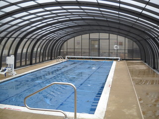 Pool enclosure Laguna - a commercial application over hotel pool - look from inside of enclosure