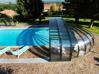 Swimming pool enclosure OLYMPIC spans beautifully in your yard