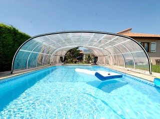 The look of opened swimming pool enclosure OLYMPIC