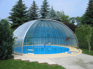 High oval pool enclosure ORIENT - in the corner of the garden