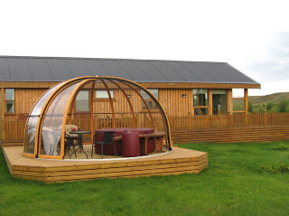 Pool enclosure ORIENT with woold-like finish used on its frames