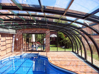 Patio enclosure style photogallery sunrooms for Retractable pool enclosures cost