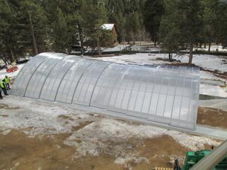 Pool enclosure used over water reservoir