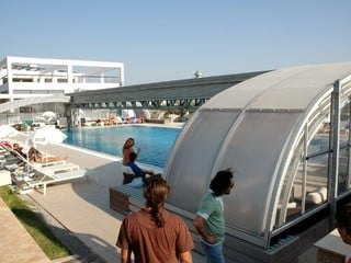 Public pool enclosure - opened while nice weather