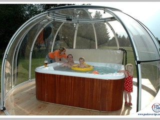 Relax with family under hot tub enclosure