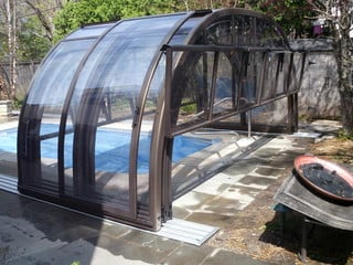 Retractable pool enclosure Laguna with front facing wall opening