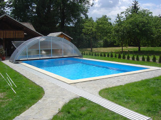 Swimming pool enclosure UNIVERSE allows you to use your pool form spring to autumn
