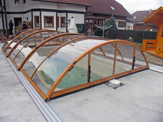 Popular wood-like finish used on pool enclosure UNIVERSE