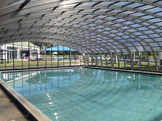 Retractable swimming pool enclosure - commercial application over hotel pool