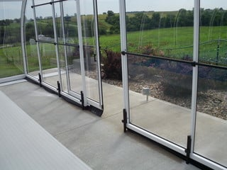 Sliding doors in the front facing wall of pool enclosure Laguna