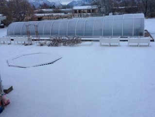 Swimming pool enclosure Laguna covered by the snow