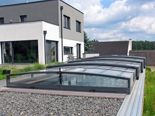 Swimming pool enclosure Viva with modern house in the background